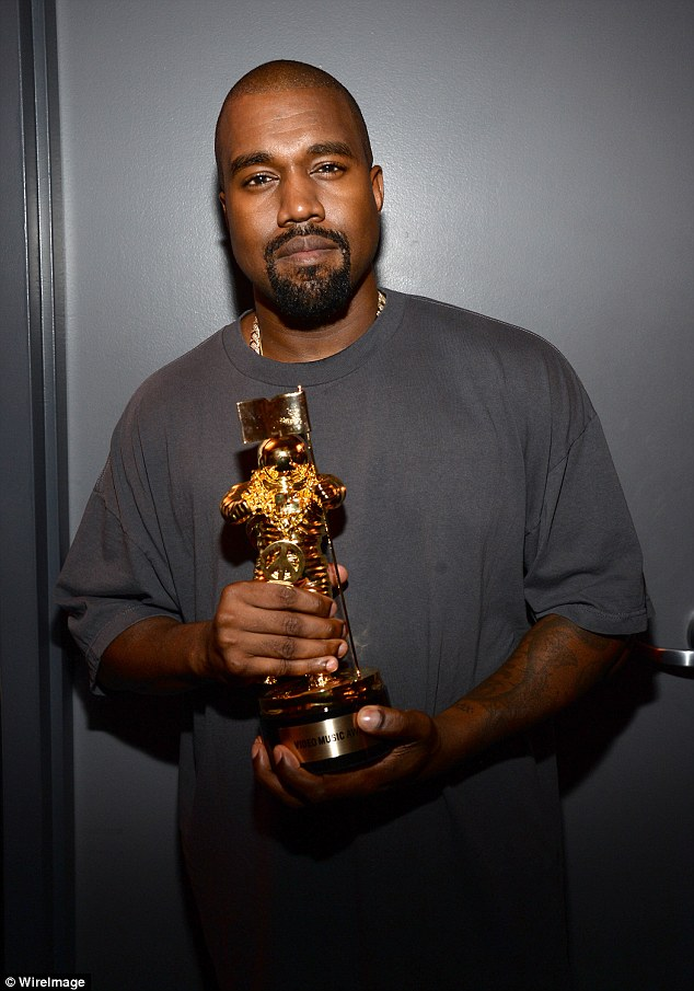 What an honour: Kanye posted backstage with his mooonman, which this year was designed by Jeremy Scott