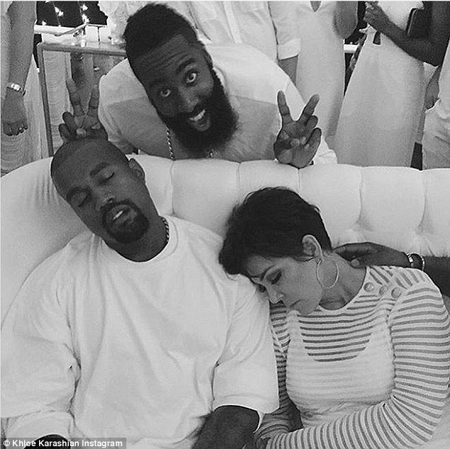 Late night: Khloie shared this Instagram photo of mom Kris and Kanye West struggling to stay awake for the fireworks at midnight while Harden pulled a funny face behind the dozing pair