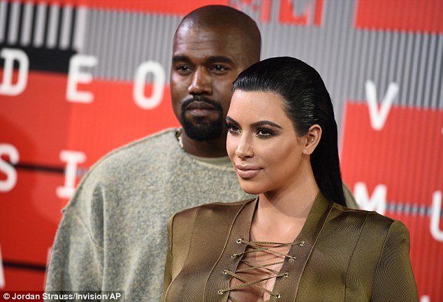 Juggling act:Balancing out the dress' impact, Kim wore her hair slicked back and straight and her make-up rather natural for a Kardashian