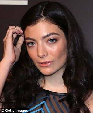 Pretty: She wore dewy foundation, a touch of bronzer, eyeliner and gloss