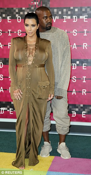 Maternity wear: The reality star showed off her changing physique in a bronze Balmain full length gown