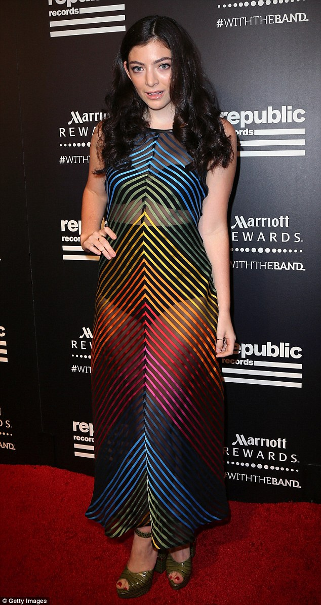 Putting her best foot forward: Singer Lorde stepped out at the Republic Records private post-VMAs celebration on Sunday night wearing a sheer rainbow-coloured dress