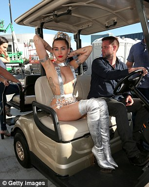 Arriving in style: Miley was chauffeured in a golf cart to the theatre