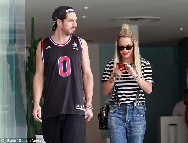 The day before the awards ceremony, Ora's rose tattoo could clearly be seen as she looked at her phone while leaving The Standard hotel with a male friend