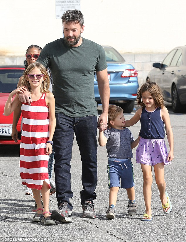 Family time: Ben Affleck enjoyed a day out with his children Seraphina, six, Violet, nine, and Samuel, three,  in Santa Monica on Sunday