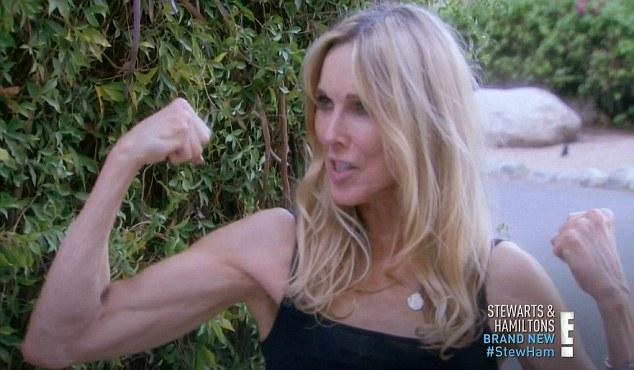 Texas strong: Alana flexed her muscles while reminding George that she's from Texas