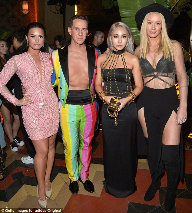 Host with the most! DesignerJeremy Scott wore a bold trouser and jacket combo without a shirt underneath for the event and showed off his waxed chest as he posed alongside Demi, Iggy and Korean popstar CL
