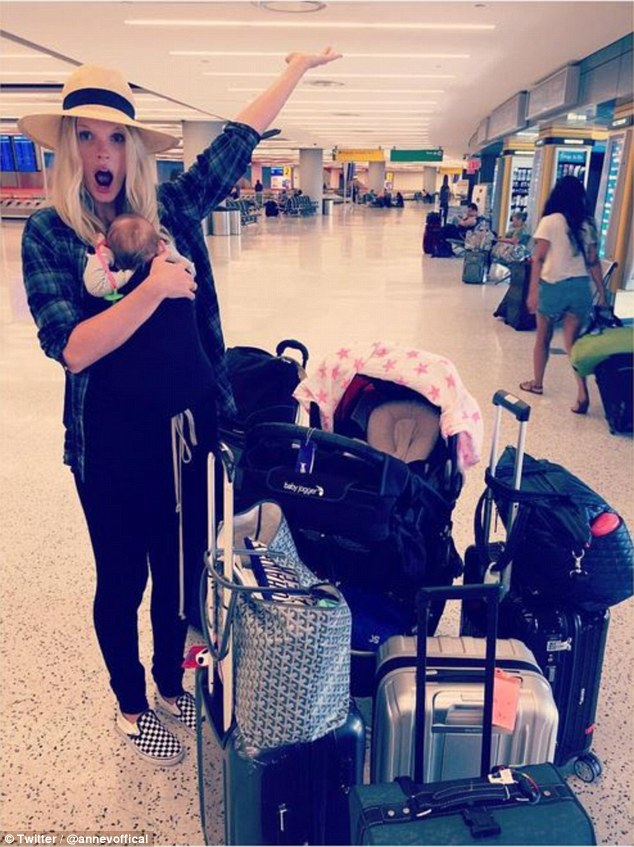 Frequent flyer: The 29-year-old, who gave birth to her daughter Alaska on June 25, also shared this image of herself and her newborn at the airport surrounded by luggage on Sunday