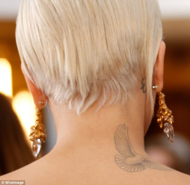 Just like Rihanna: Ora sports a pink dove on the top of her right shoulder