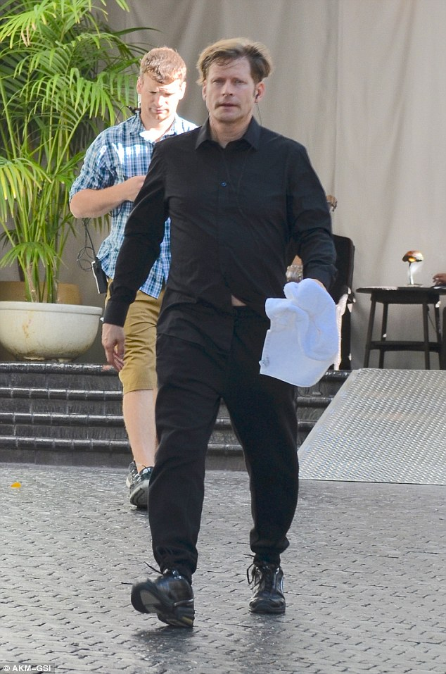 Hot look: Co-star Crispin Glover was seen as well, wearing all black and sweating as he walked at the Chateau Marmont