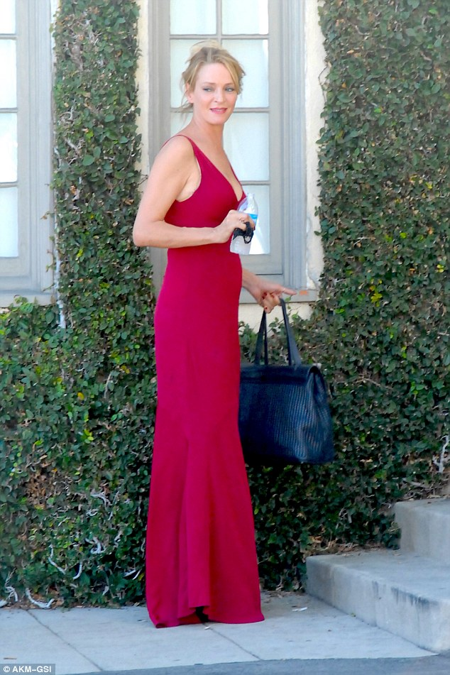 Red hot:Uma Thurman looked every inch the timeless Hollywood icon as she took a break on the set of The Brits Are Coming in West Hollywood on Sunday