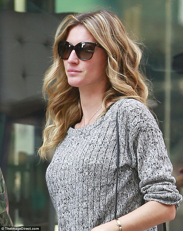 Enhanced: Gisele Bundchen is believed to have undergone a boob job and eye lift at a plastic surgery clinic in Paris in mid-July. On Sunday, she was out and about in NYC wearing a sweater despite the 90 degree heat