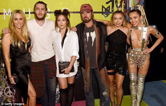 They must be so proud: Miley Cyrus' family lent their support as the scantily-clad star hosted the most outrageous MTV Video Music Awards yet on Sunday night