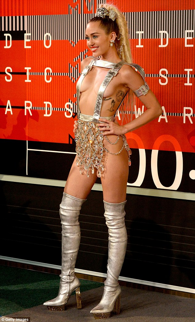 Where to look?Rebel, 35, is certainly onto something with 22-year-old Miley walked the red carpet in an out-there silver ensemble that barely covered her modesty