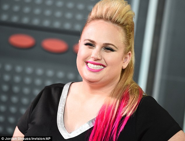 Hawt pink!Her blonde tresses were backcombed into a sky-high quiff, while she added some hot pink tips to brighten up her look