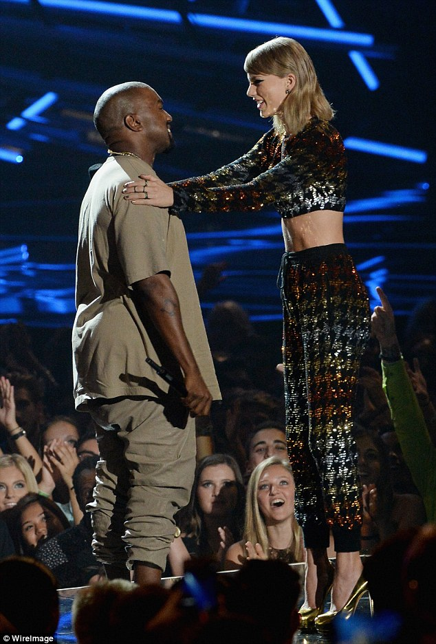 Burying the hatchet: Taylor Swift presented Kanye West with the Video Vanguard award at the 2015 MTV VMAs on Sunday, six years on from their infamous encounter at the same ceremony