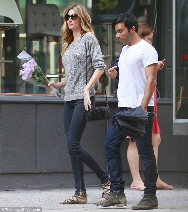 Sunday stroll: Gisele, who's married to NFL quarterback Tom Brady, was joined by celebrity hairstylist Harry Josh, who's a friend