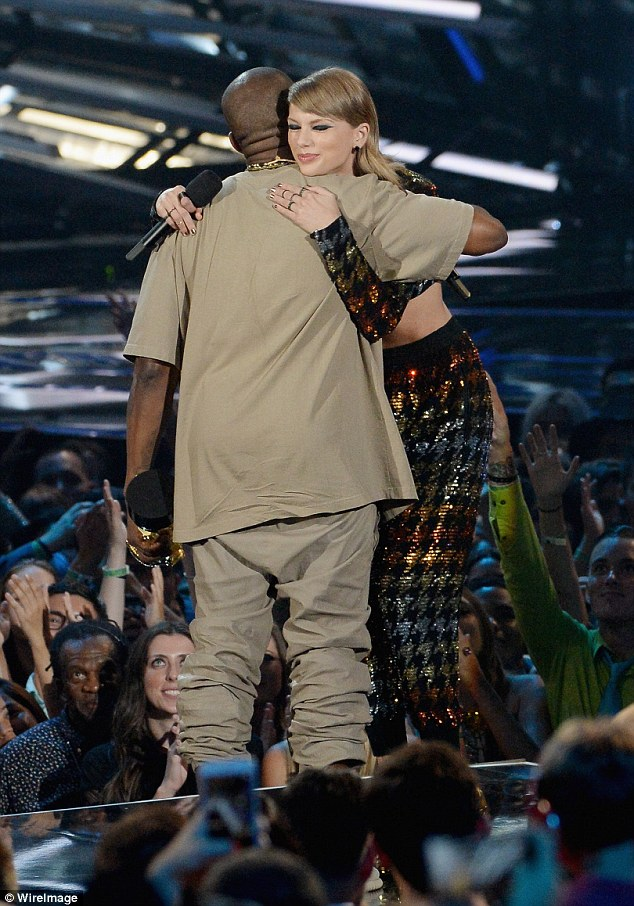 Forgiven: Kanye and Taylor embraced on stage after she finished her introduction exclaiming how talented the rapper is