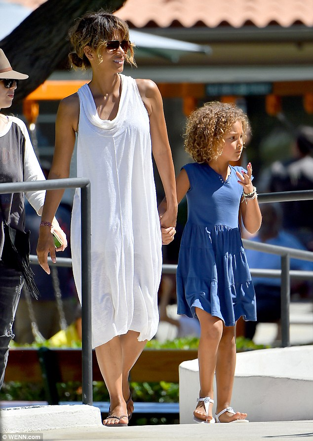Easy breeze: The Extant star held hands with her daughter Nahla as they walked to a park at the Mart