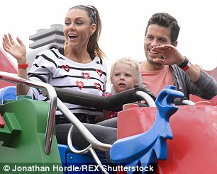 Smile and wave: Michelle and Hugh encouraged Faith to wave to the people below but she looked a little scared