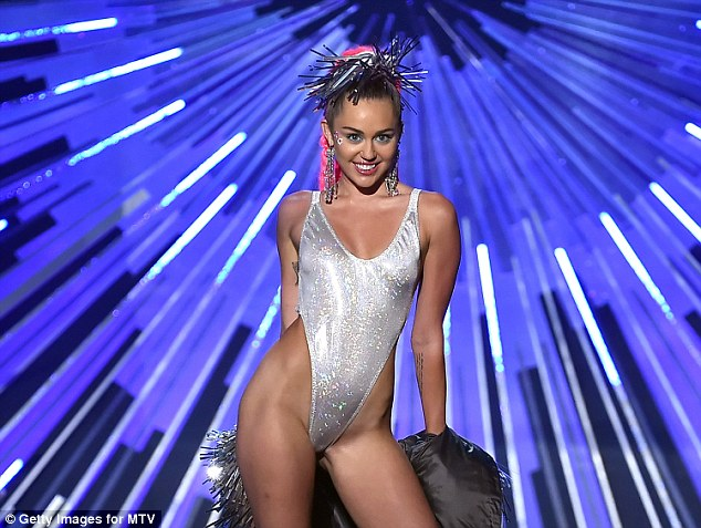 No thanks: Miley Cyrus says she's not interested in being in Taylor Swift's 'squad' of famous friends, because she finds 'real people' more inspiring; here she is seen on Sunday at the MTV VMAs