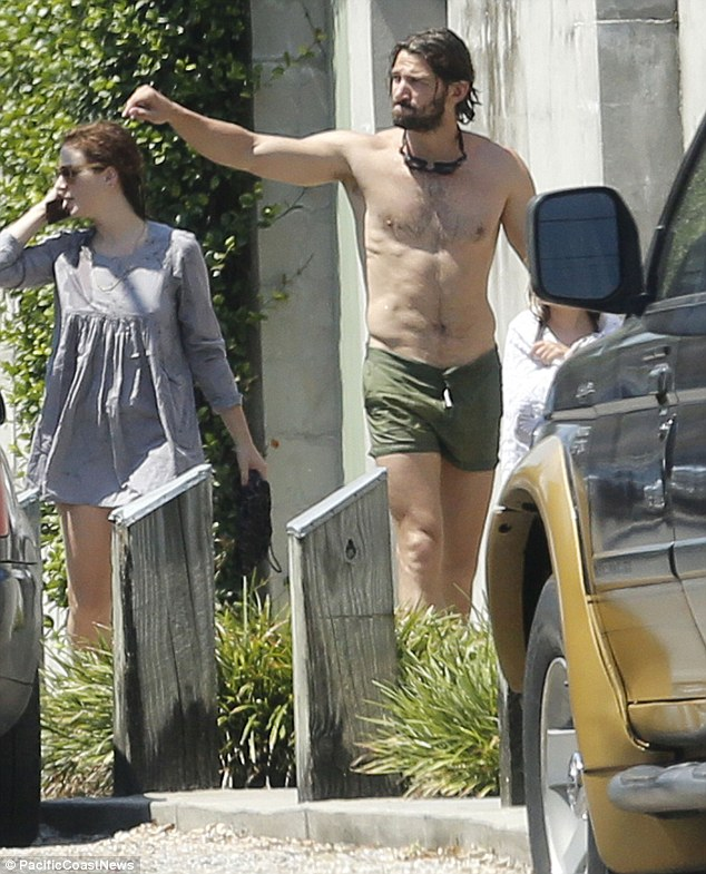 No cover up necessary: The 34-year-old Game Of Thrones star was joined by his actress wifeTara Elders, 35, and theireight-year-old daughter Hazel, who was wrapped in a towel