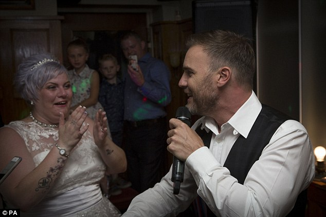 Katie, 33, had no idea Gary Barlow would perform at her wedding and the lifelong Take That fan was visibly shocked to see him