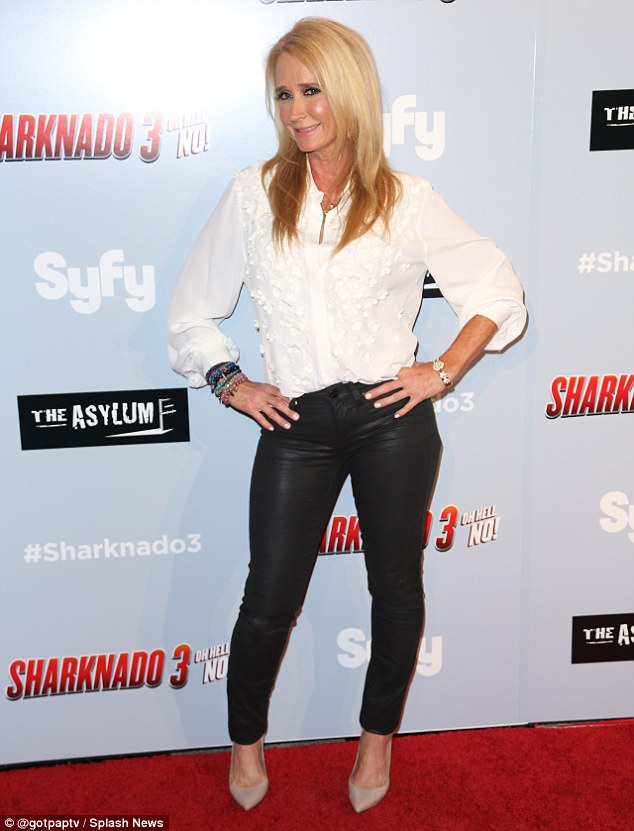More legal trouble: Kim - pictured at the Sharknado 3 premiere in July - faced her second arrest in recent months on August 2, after she allegedly tried to steal more than $600 worth of merchandise from Target