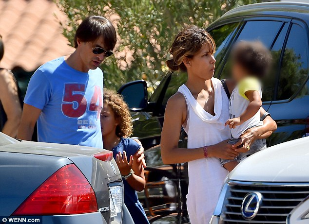 All together now: Also with the Oscar winner was her French husband Olivier Martinez, who is also 49