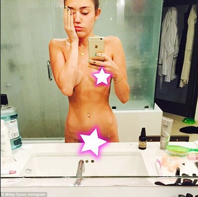 Not shy: Cyrus posted a naked selfie to Instagram before heading off to host the VMAs on Sunday