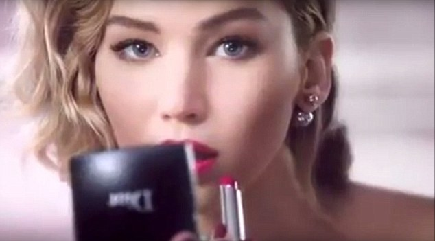 Perfection: She wears the fuschia lipstick from the Be Dior range as she smoulders in front of the camera
