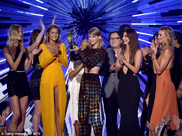 Famous friends: Swift brought her Bad Blood squad, including Hailee Steinfeld, Gigi Hadid and Karlie Kloss, on stage as she accepted the Video Of The Year Award on Sunday at the VMAs
