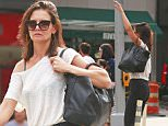 EXCLUSIVE: Katie Holmes carries her oversized bag while hailing a cab on Fifth Avenue in New York City.\n\nPictured: Katie Holmes\nRef: SPL1111982  300815   EXCLUSIVE\nPicture by: Splash News\n\nSplash News and Pictures\nLos Angeles: 310-821-2666\nNew York: 212-619-2666\nLondon: 870-934-2666\nphotodesk@splashnews.com\n