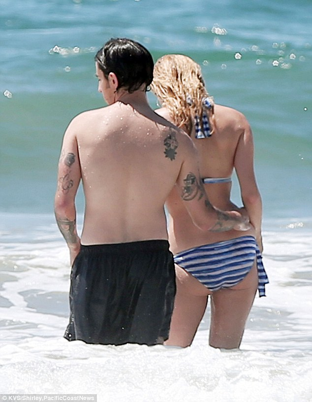 Attached at the hip! The twosome stayed close as they ventured into the surf