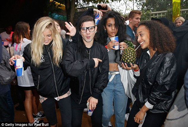 Popular guy: Skrillex was joined by a group of female friends at the party on Monday