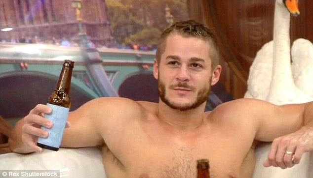 Loving life: Austin cut a handsome figure as he indulged in a bottle of beer while sitting on the sofa