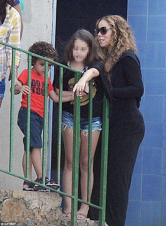 Talking to the children: The mother of four-year-old twins, Moroccan and Monroe, made time for the younger ones in the lunch party