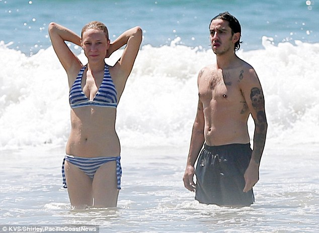 Making waves: The pair no doubt had a lot of fun as they frolicked through the surf