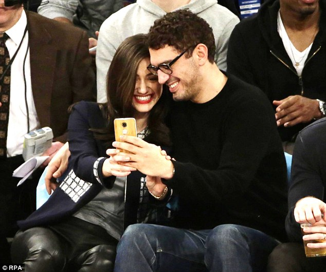 A cute selfie? The two looked at her phone while taking in a New York Knicks versus Dallas Mavericks game in NYC in December