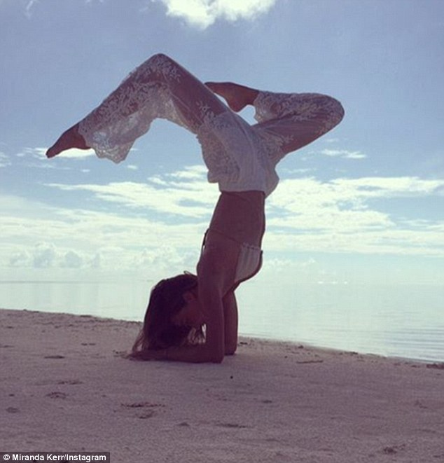 Namaste! The Australian model Miranda Kerr took to social media on Tuesday practicing an elaborate handstand with her slender pins over her head on the beach