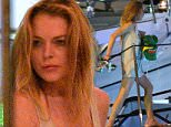 August 30th, 2015 - Saint Tropez  ******Excluisve Picture ******  After having spent a drunken night out with his friends at the famous artist photographer Philipe Shangti\'s restaurant L\'OPERA, Lindsay Lohan has returned to her boat 3am moored in the Saint Tropez harbour. Just arrived on board, a violent argument began between Lindsay and a friend. Hysterical, the very drunk American actress screamed with all his might under the stunned yacht captain eyes awakened by the cries. After the fight Lindsay Lohan isolated herself at the front of the boat where she was finally joined by her boyfriend.   ****** BYLINE MUST READ : © Spread Pictures ******  ******Please hide the children\'s faces prior to the publication******  ****** No Web Usage before agreement ******  ****** Stricly No Mobile Phone Application or Apps use without our Prior Agreement ******  Enquiries at photo@spreadpictures.com