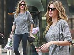 08/30/2015\nExclusive Gisele Bundchen walks up broadway in New York carrying flowers and walking with a friend. Magazines have been speculating that the worlds highest paid model and husband Tom Brady are having marital problems. The couple have not been spotted together in months. The super model has been spotted exactly once since her rumor of plastic surgery. \nsales@theimagedirect.com Please byline:TheImageDirect.com\n*EXCLUSIVE PLEASE EMAIL sales@theimagedirect.com FOR FEES BEFORE USE