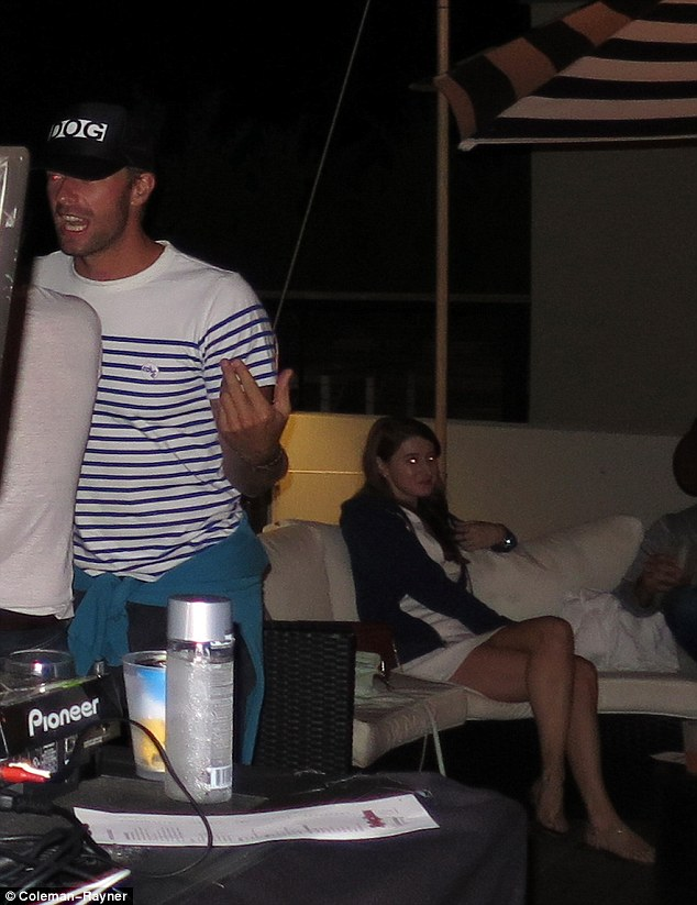 Casual: He tied his trademark sweater around his waist as he got stuck into the music