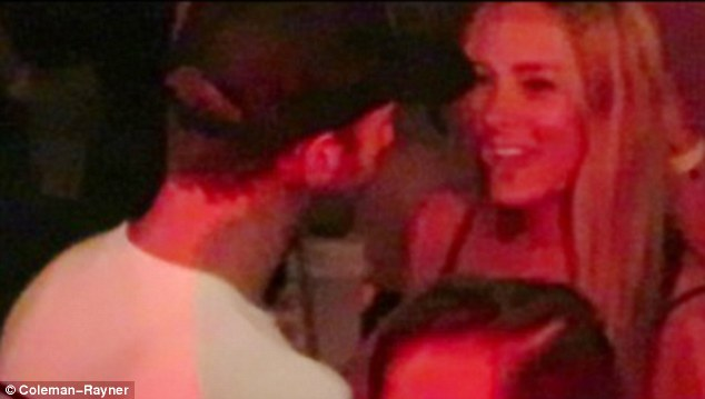 Getting to know you: He was pictured getting flirty with a very pretty blonde while on the dancefloor
