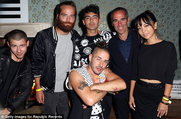 Just another night in WeHo: Nick and Joe later cosied up with music mogul Monte Lipman and his entourage