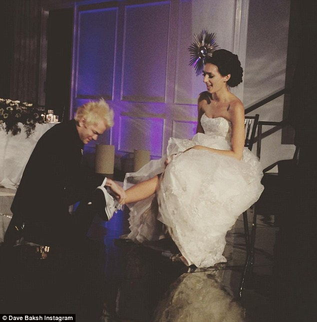 Punk Cinderella: Whibley kneels down to tie his new wife's Converse sneakers