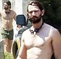 141680, EXCLUSIVE: Age of Adaline star Michiel Huisman is seen leaving a pool party with his actress wife Tara Elders and daughter Hazel in New Orleans. The shirtless actor, who also plays Daario Naharis in the TV series Game of Thrones, showed off his wet and muscular body. He wore green short swim trunks, Tara wore a purple dress cover up while Hazel chose to keep warm in her towel. New Orleans, Louisiana - Saturday August 29, 2015. Photograph: © PacificCoastNews. Los Angeles Office: +1 310.822.0419 sales@pacificcoastnews.com FEE MUST BE AGREED PRIOR TO USAGE