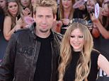 """****File Photos** AVRIL LAVIGNE SPLITS FROM CHAD KROEGER Pop punk AVRIL LAVIGNE and rocker CHAD KROEGER have separated after two years of marriage. The Sk8er Boi hitmaker, 30, wed the Nickelback frontman, 40, in July, 2013 after a whirlwind romance, but they have been dogged by rumours of an impending split for the past year, and on Wednesday (02Sep15), the unlikely couple finally confirmed the news. Lavigne took to Instagram to share a photo from the stars' wedding day, and captioned it, """"It is with a heavy heart that Chad and I announce our separation today. """"Through not only the marriage, but the music as well, we've created many unforgettable moments. We are still and forever will be, the best of friends, and will always care deeply for each other. To all our family, friends and fans, thank you sincerely for the support."""" The separation announcement comes just days after Lavigne's ex-husband Deryck Whibley tied the knot. The Sum 41 star exchanged vows with his fiancee Ariana Coope"""