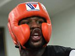 LAS VEGAS, NV - AUGUST 26:  Boxer Floyd Mayweather Jr. yells as he spars during a media workout at the Mayweather Boxing Club on August 26, 2015 in Las Vegas, Nevada. Mayweather will defend his WBC/WBA welterweight titles against Andre Berto on September 12 at the MGM Grand in Las Vegas.  (Photo by Ethan Miller/Getty Images)