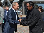 Russian President Vladimir Putin (L) shakes hands with US action movie actor Steven Seagal (R) at the Russia's first ever Eastern Economic Forum (EEF) in Vladivostok on September 4, 2015. AFP PHOTO / RIA NOVOSTI / POOL / ALEXEY DRUZHININALEXEY DRUZHININ/AFP/Getty Images